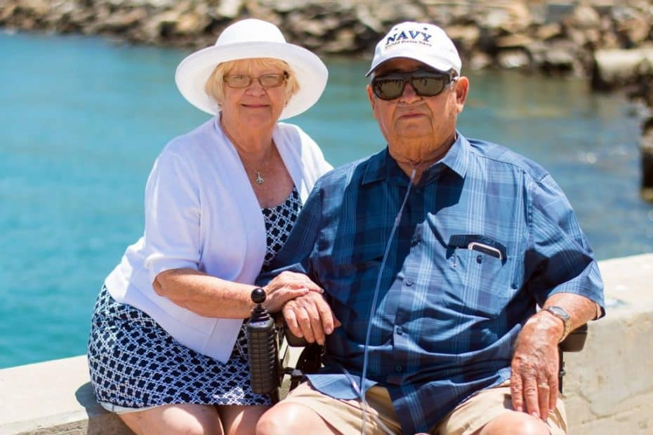 Older couple sitting by water