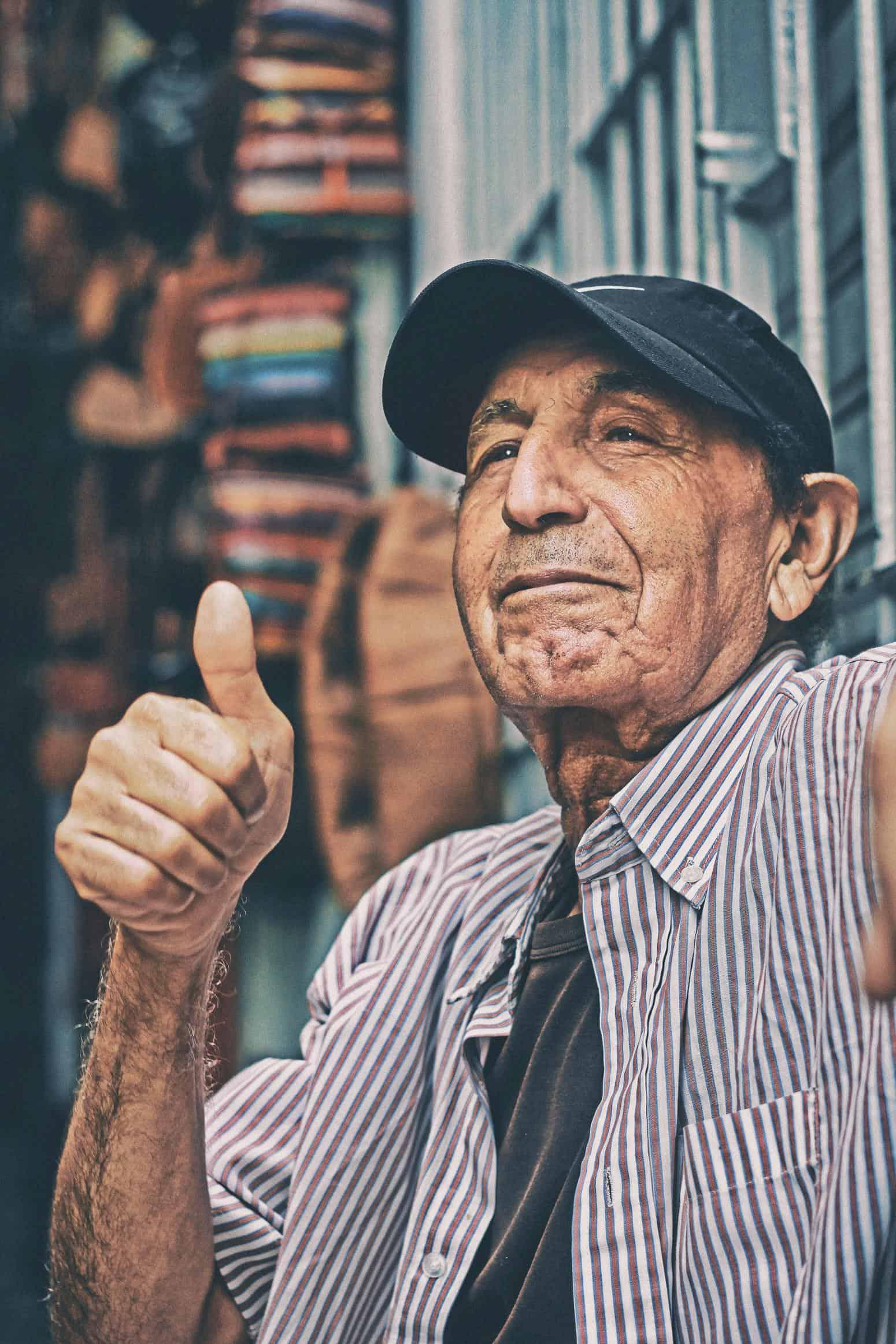 thumbs up elderly gentleman